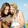 Girls having fun using tablet — Stock Photo #63155145