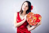 Woman with heart present boxe — Stock Photo