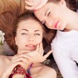 Girls lying on ground — Stock Photo #63740375