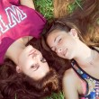 Girls lying on grass — Stock Photo #63740463