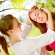 Two girls under tree — Stock Photo #63740477
