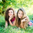 Girls lying on grass — Stock Photo #63740485
