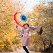 Jumping girl with umbrella — Stock Photo #64241627