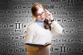 Lady in glasses reading book — Stock Photo