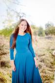 Girl in a blue dress — Stock Photo