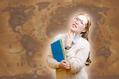 Lady with books on old map backgground — Stock Photo