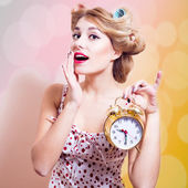 Surprised woman with alarm clock — Stock fotografie