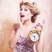 Surprised woman with alarm clock — Stock Photo