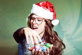 Girl saving Christmas tree toys — Stock Photo