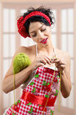 Brunette pinup lady with needlwork — Stock Photo