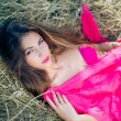 Sexi pensive young lady with long hair in pink — Stock Photo #81060774