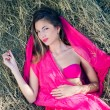 Young lady relaxing on heap of hay — Foto Stock #81654342