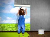 Funny child hanging wallpaper, doing repairs. — Stock Photo