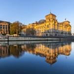 Постер, плакат: Reichstag with reflection in Spree Berlin