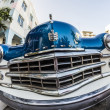 Постер, плакат: Dodge Vintage car parked at Ocean Drive in Miami Beach