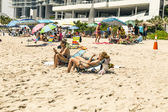 People enjoy and relax the beach in Sunny Isles near the pier — Stock Photo