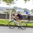 An athlete cycles in the Cologne Triathlon — Stock Photo #52842963