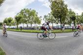 An athlete cycles in the Cologne Triathlon — Stock Photo