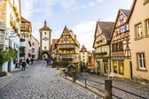 Famous old town of Rothenburg with tourists — Stock Photo