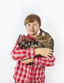 Boy hugging with his cat — Stock Photo