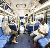 People in the downtown Metro bus in the evening — Stock Photo