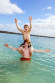 Boys having fun in the clear sea  — Stock Photo