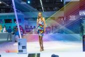 Models pose for visitors at  Photokina in Cologne — ストック写真