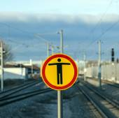 Sign Beware of trespassing at train station — Stock Photo