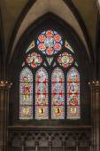 Beautiful windows of the minster show religious scenes from the  — Stock Photo