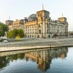 Постер, плакат: Reichstag bundestag with reflection in spree river in berlin