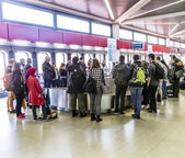 People wait at baggage belt  in  Tegel airport — Stock Photo