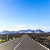 Driving by car in the Timanfaya volcanic national park i — Stock Photo