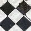 Black and white pattern od squares at the street — Stock Photo #60692451