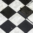 Black and white pattern od squares at the street — Stock Photo #60692475