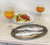 Cooking fish in oven at home kitchen — Stok fotoğraf