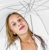 Girl poses with umbrella in studio — Stock Photo