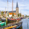 Pier with old boats in Harlingen — Stock Photo #63124447