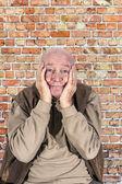 Portrait of elderly man in sorrow  — Stock Photo