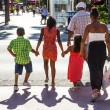 Постер, плакат: People go shopping in the afternoon sun in Lincoln Road