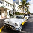 Classic Oldsmobile with chrome radiator grill parked in front of — Stock fotografie #65406949