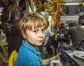 Boy enjoys eating at the night market — Stock Photo