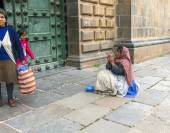 Poor people beg for an alm in front of the basilica de la cathed — Stock Photo