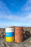 Old rusty colorful barrels in volcanic landscape in Timanfaya na — Stock Photo