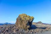 Volcanic bomb in front of volcano Montana Colorada in Lanzarote, — Stock Photo