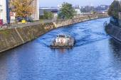 Berlins buildings and a boat shipping at the river Spree — Stock Photo