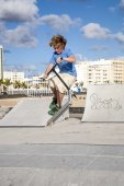 Boy with scooter is jumping at the skate park — Stock Photo