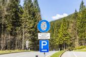 Snow chain sign with parking place to change — Stock Photo