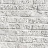 White painted bricks at an old house wall — Stock Photo