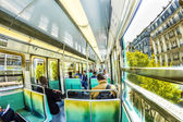 Tourists and locals on a subway train in Paris — Stock Photo