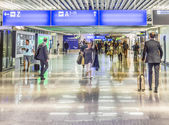 People at the Airport in the evening in Frankfurt, Germany — Stock Photo